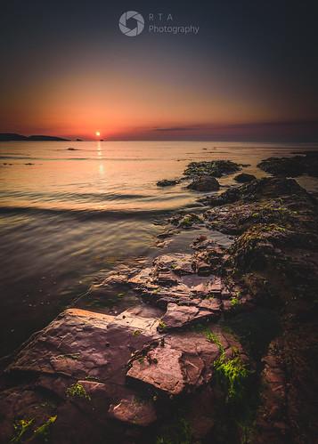 devon torbay goodringtonsandsbeach rtaphotography light sunrise seascape dawn horizon nikon d750 1835 nikkor hardgrad 2stop rocks southdevon sea water sun nature outdoors smooth seaweed portrait colour glow orange coastal