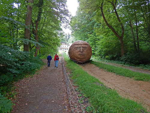 Sisyphus, a huge rolling stone sculpture that is periodically hauled up the hill at the Silkeborg Sculpture Garden in Denmark