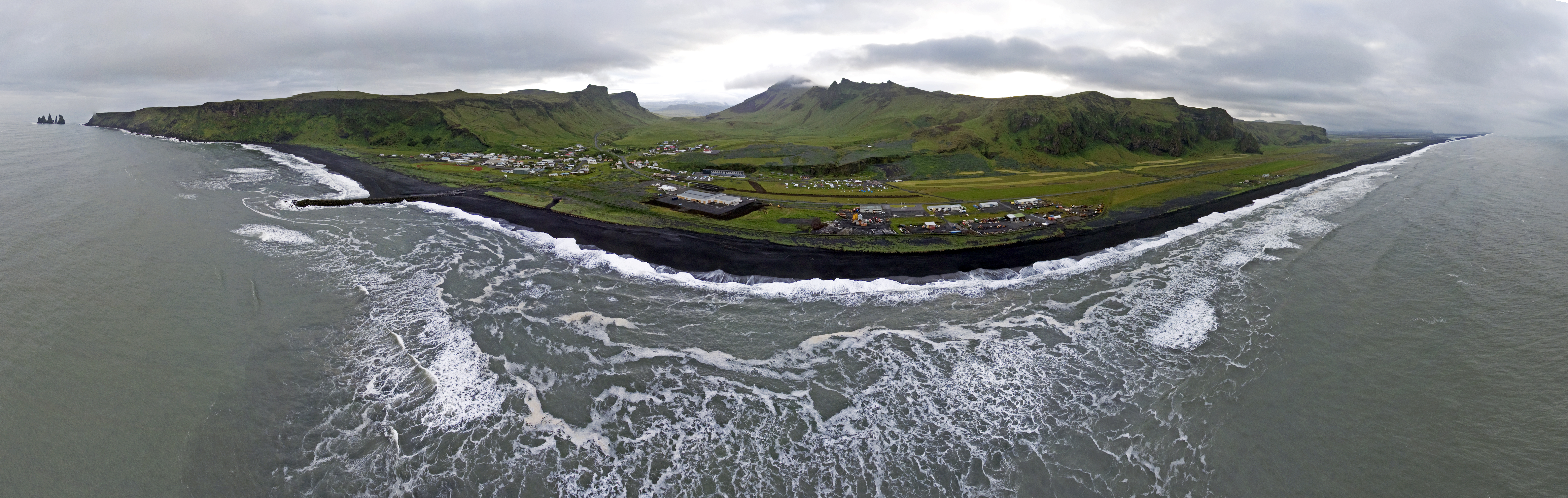 Vík í Mýrdal Aerial Panorama from out at sea. Photo taken on June 16, 2017.