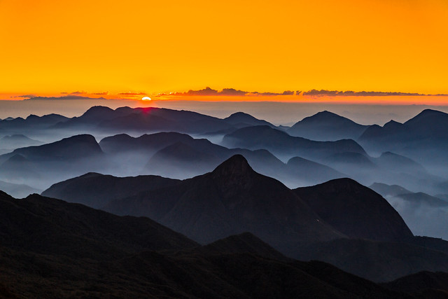 The silhouettes of the mountains.