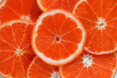Closeup of sliced juicy blood oranges textured background