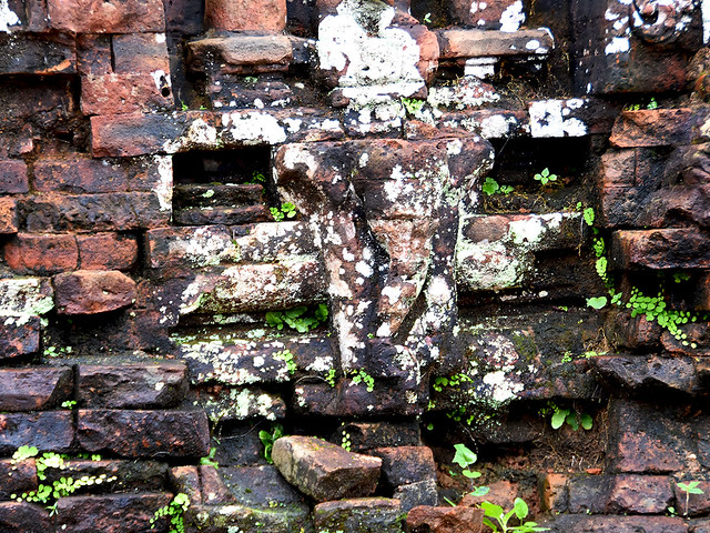 remains of an elephant head sculptured into the brickwork of an alter at the sacred Champa site of My Son in ancient Vietnam