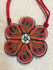 Large poppy pendant.