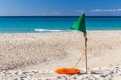 Green flag on the Varadero beach on a sunny day