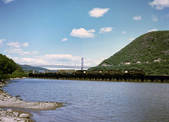 A Penn Central GP38 leads two GP40 and a GP30 south bound over Iona Trestle in Bear Mountain NY, summer 1976