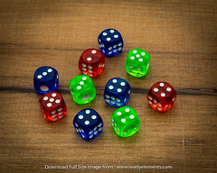 Colorful dices on wooden background