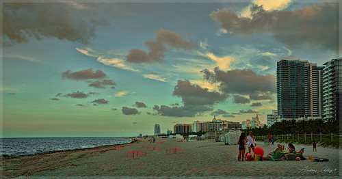 miamibeach lateafternoon shore seashore seascape beach beachscape beachshore outdoors people perspective skies architecture afternoon walkingaround waterways walking