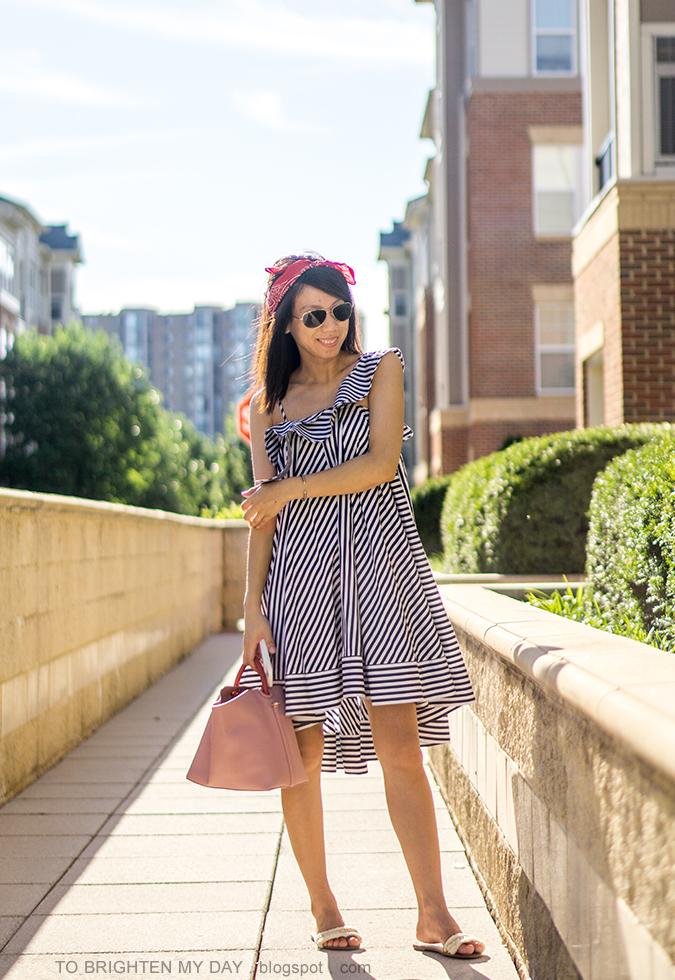 red bandana as headband, striped ruffle midi dress, pink bucket tote, white flats with fringe, silver cuff