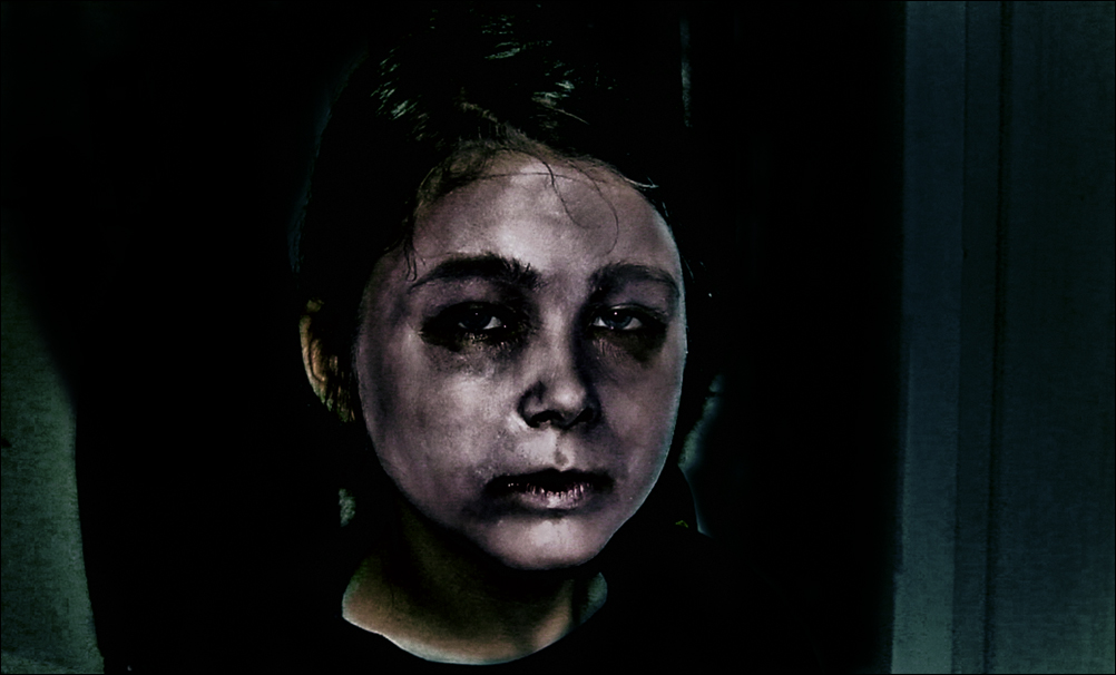 The Child Experiments with Being an Actor in Dramatic, Scary Stage Make-up