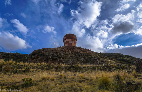 travel peru andes altiplano sky mountain ancient tower people cloud grass sillustani building architecture stone