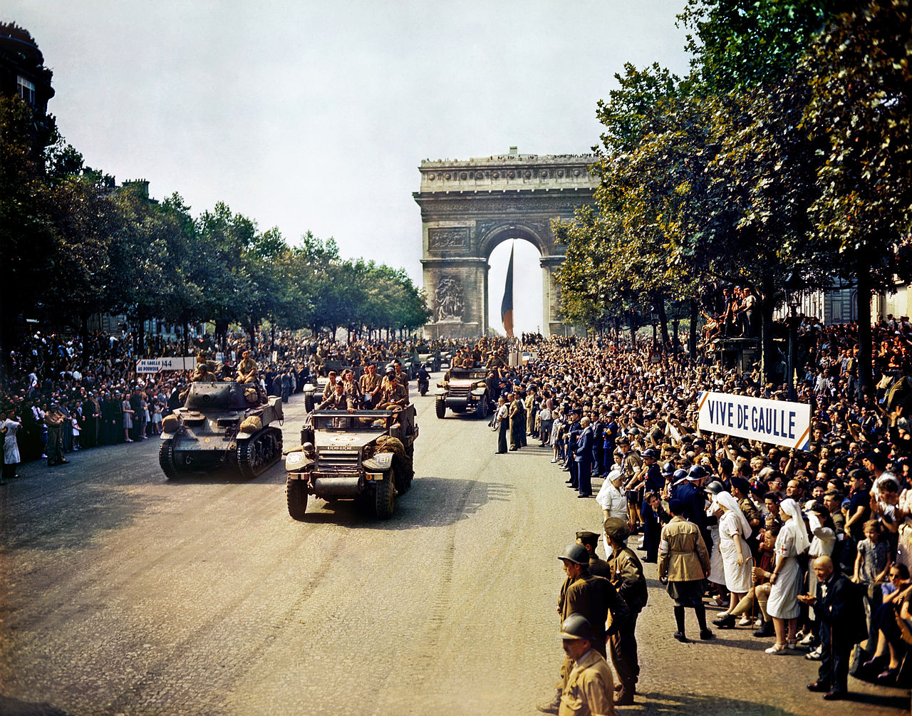Crowds of French patriots line the Champs Elysees to view Free French tanks and half tracks of General Leclerc's 2nd Armored Division passes through the Arc du Triomphe, after Paris was liberated on August 26, 1944. Among the crowd can be seen banners in support of Charles de Gaulle. Photo taken by Jack Downey, U.S. Office of War Information. From the repository of the Library of Congress Prints and Photographs Division Washington, D.C. 20540 USA.