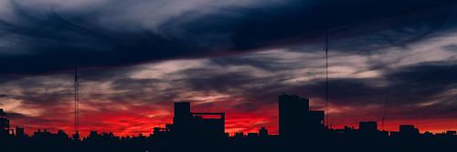 sky sunset sunrise sun clouds skyline cityscape city architecture