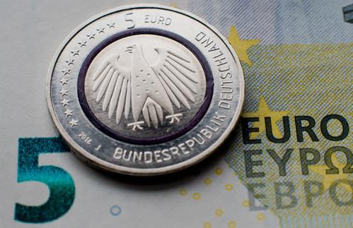 Five euro coin planet erde