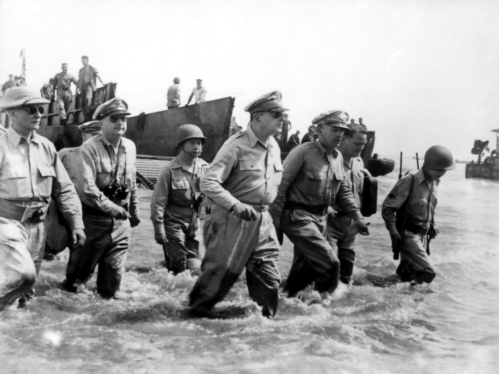 U.S. General Douglas MacArthur wades ashore during initial landings at Leyte, Philippine Islands in October 1944.