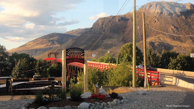 The Red Bridge, Mount Paul & the Rocky Mountaineer at Kamloops Railway Station, British Columbia, Canada
