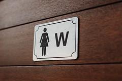 Close up of women bathroom sign