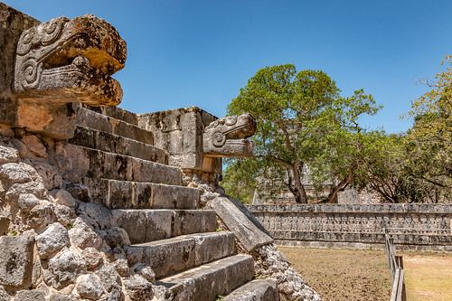 Stone carvings and the Wall of Heads within Chichen Itza, Mexico
