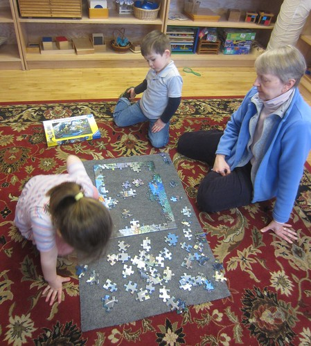 100 piece dinosaur puzzle assembly team work