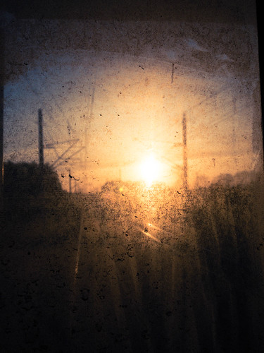 122 sunset through dirty train window
