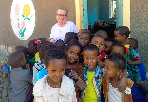 Bernie Sheridan SSL poses with some of the children of the Kindergarten School in Dawhan, Ethiopia