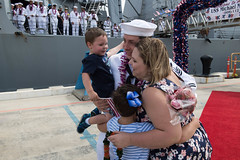 PEARL HARBOR (April 18, 2018) Operations Specialist 1st Class Michael Grimstead, Irvine, California, receives the first hug during the homecoming celebration for the guided-missile destroyer USS Michael Murphy (DDG 112). Michael Murphy returns home to Joint Base Pearl Harbor-Hickam after a three-month deployment to the Western Pacific with the Carl Vinson Strike Group. The crew of 350 Sailors conducted training with the French navy and visited the Philippines and Guam. USS Michael Murphy also completed a joint Oceania Maritime Security Initiative (OMSI) patrol with the U.S. Coast Guard. (U.S. Navy photo by Mass Communication Specialist 3rd Class Jessica O. Blackwell)
