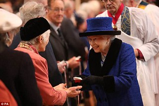 Queen Elizabeth II giving maundy coins