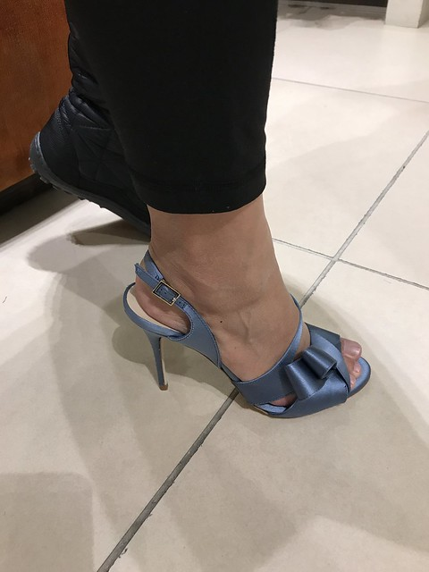 Oyen trying on blue satin shoes