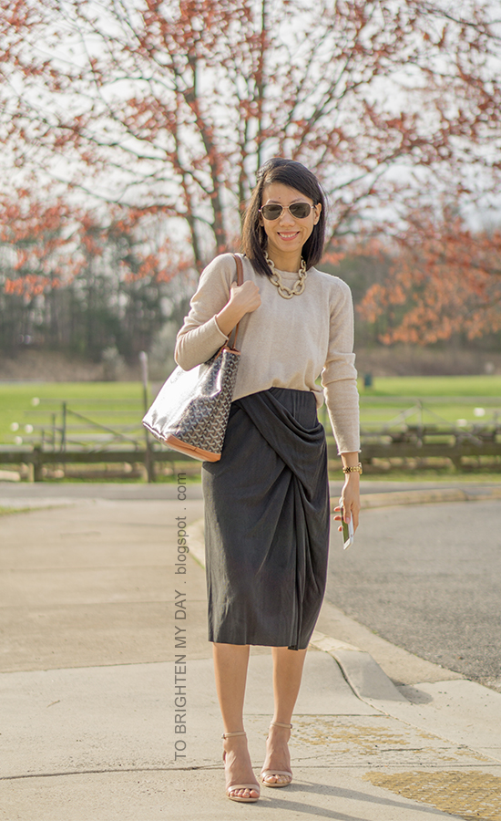 gold link pave necklace, camel cashmere sweater, dark gray draped midi skirt, gold watch, monogrammed tote, nude sandals