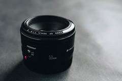 Close up of camera lens on dark background