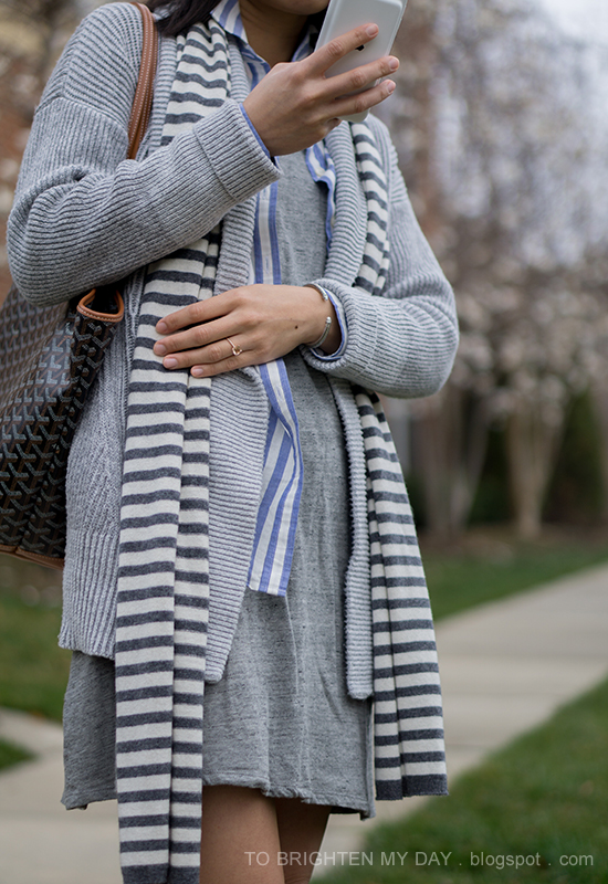 striped scarf, gray oversized open cardigan sweater, blue striped shirt, gray dress, printed tote