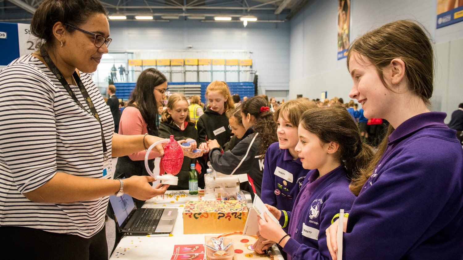 School pupils looking at a science stand