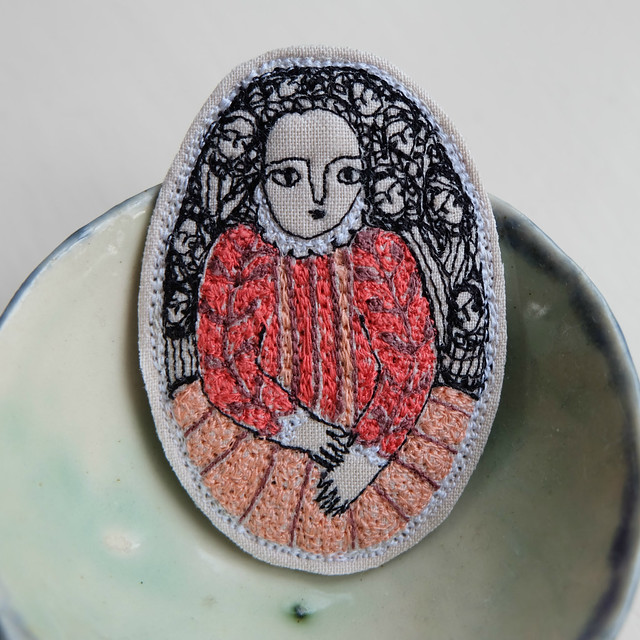close up of embroidery portrait brooch