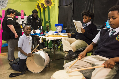Members of Wild Opelousas and teachers Liz Arias and Jamal Casby work on suits and get ready for practice on January 9, 2018. Photo by rhrphoto.com.