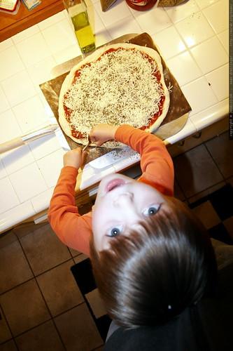 pizza chef   nick adds oregano    mg 2109