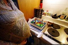 nick's baby brother lighting the birthday candles   …