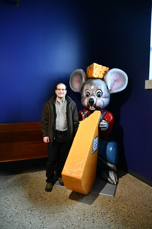 Chris poses for a cheesy photo with the giant mouse.