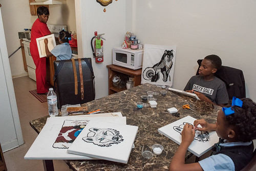 Tycen sewing at home with his family on November 29, 2017. Photo by rhrphoto.com.