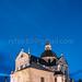 Nesvizh, Minsk Region, Belarus. Corpus Christi Church In Evening Or Night Illuminations. Famous Landmark In Nyasvizh
