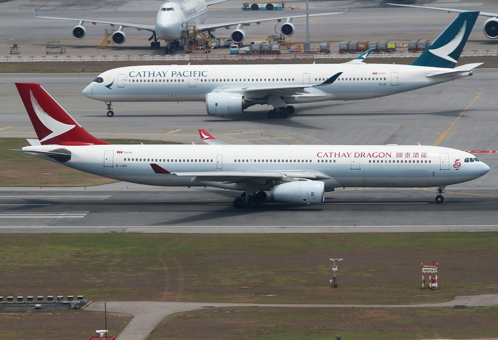 Which one do you prefer, red or green? Speeding up on RWY07R for departure. Delivered 10/2014 to Cathay Pacific.
