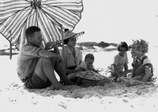 Mr and Mrs J. Bell and family enjoying the beach at Burleigh Heads 1938