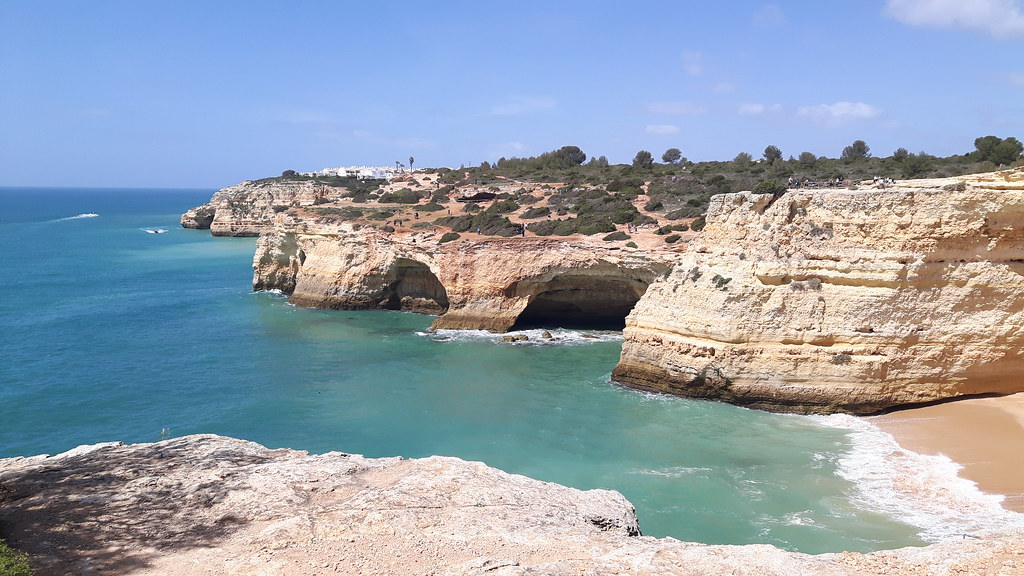 Algarve cliffs, caves and turquoise waters in Portugal.