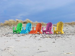 Coulourful chairs at the beach