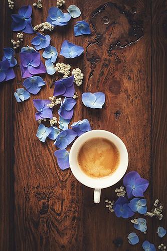 Coffee time and blue petals