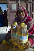 """May Alati is 36 years old and a mother of five children. She was born in a refugee camp and has lived there all her life. """"Conditions are difficult,"""" she admits, """"but fortunately we have our basic needs covered"""".   She likes to come early to the food distributions to pick up her rations. """"I get oil, flour, barley, sometimes wheat, and also rice and lentils. If I don't get this, I have nothing. We survive thanks to humanitarian aid. There is no work here,"""" she says.    © European Union 2018 (photo by Louiza Ammi)"""