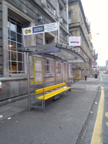 Nichols Street bus shelter with yellow bench, Liverpool, Merseytravel