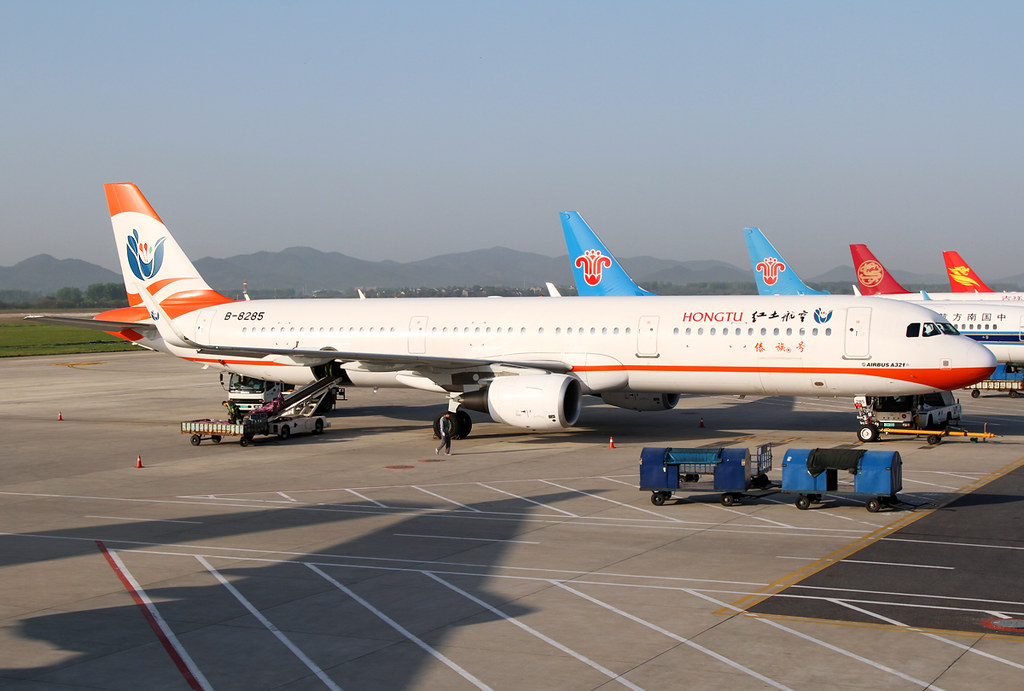 Resting on the ramp before a flight to Kunming KMG. Delivered 12/2014 to UTair.