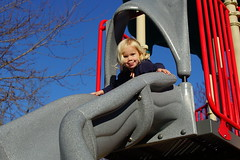 Madeleine smiles as she gets ready to go down the slide