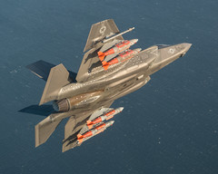 An F-35C Lightning II conducts external weapons tests.