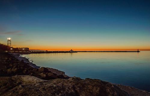 petoskey michigan longexposure color sundown sunset reflections water sea seascape lake bay lakemichigan littletraversebay clocktower pier breakwall lighthouse dusk bluehour