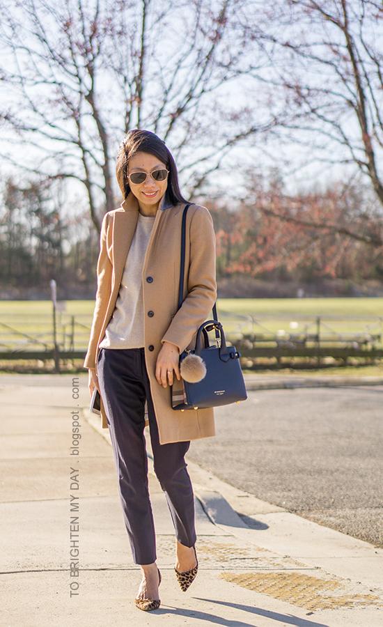camel long coat, cashmere sweater navy pants, leopard pumps, navy shoulder bag with pom keychain